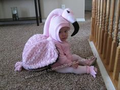 Baby Flamingo DIY Costume: So I bought my daughter some puppets and her favorite one was the flamingo. This poor flamingo puppet endured many, many, beak biting sessions from my
