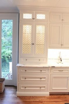 Love the full length slightly set back and the in and under cabinet lighting