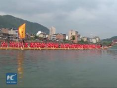A 15-tonne, 77.8-meter-long canoe was carried through the streets of an ethnic county in southwest China's Guizhou Province during a rehearsal for a ceremony to mark the upcoming Dragon Boat Festival.