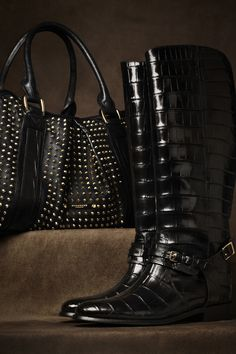 Burberry...Forget the bag...Those BOOTS are running wild in my imagination! Black leggings and a riding crop, anyone?