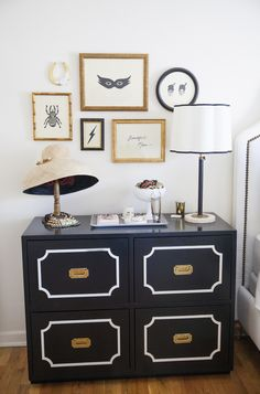 black and white dresser- white accents to break up so much black in the room:)