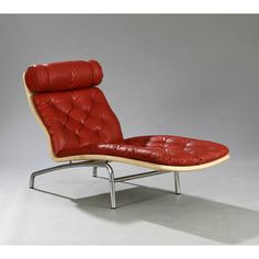 <p>Lounge chair in red leather manufactured by<span>Erik Jørgensen and designed by the Danish Arne VODDER in 1972. Structure in chromed metal with a long quilted cushion in leather and a removable headrest. In good vintage condition.</span></p>