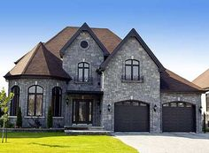 Plan 9042PD: Dramatic Stone Tower | Front door entrance, Wood front on stone building home, quonset hut home, stone castle home, stone arch home, stone cave home, stone wall home, stone temple home,