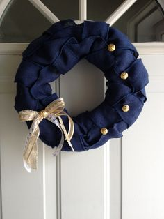 The Dress Blues Marine Corps wreath I made! Easy to make! Materials needed: blue wired burlap, wreath inside, hot glue gun, marine corps buttons and ribbon! Easy to do and only took an hour!