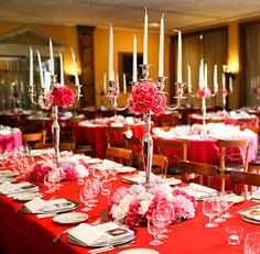 Tall candles as centerpieces, adds volume to tables without too much bulk an view blocking.