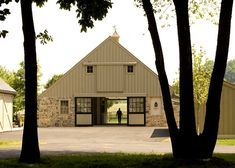 "beautifulbarns:  Archer  Buchanan Architecture, Ltd  Starry Night FarmUnionville, Pennsylvania  ""Simple in form and function, this barn was designed to evocatively mediate between the natural landscape and collection of other existing farm buildings. The six-stall barn includes fieldstone salvaged from an old barn near the property, stable yard with outbuildings for storage of equipment and visual connection with the house."""