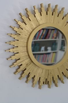 Who knew a few shims and a can of spray paint could create something so high-end–looking? Let CiBurbAnity show you how to spruce up your wall with this custom piece. Starburst Mirror, Metallic Spray Paint, Diy Mirror, Wall Mirror, Circular Mirror, Ideias Diy, Round Mirrors, Home Projects, Craft Projects