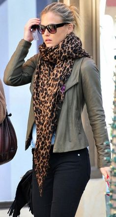 Olive leather jacket, brown and black scarf, black jeans