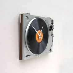 "This clock was created using a recycled Sanyo turntable and a Ronco's Greatest Hits album titled ""Get It On"" which is replaceable."