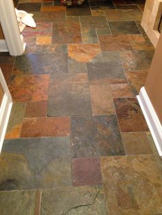 Kitchen floor. Colors to play off the copper sink and  granite countertops