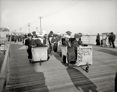Atlantic City Boardwalk, NJ  Rolling Chairs. Wearing hats and long dresses in 95 heat!? no thanks!