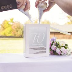 A modern twist on the original sand unity set is the Personalized Best Day Ever Unity Sand Ceremony Shadow Box Set. Featuring a contemporary shadow box to hold Wedding Sand, Wedding Ceremony Flowers, Sand Ceremony, Wedding Tips, Wedding Ceremonies, Diy Wedding, Ikea Wedding, Wedding Hacks, Church Ceremony