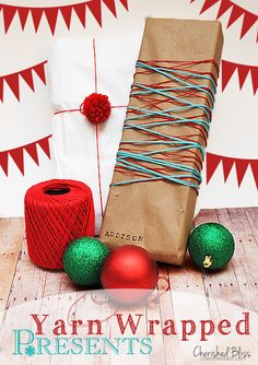 Love this simple and inexpensive-to-do Holiday Yarn Gift Wrapping Idea!