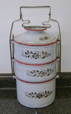 Vintage European enamelware tiffin compartmented food carrier.