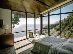 Bedroom with sea view at holiday house in the South California by Fougeron Architecture