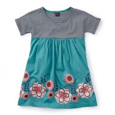 Feminine and floral, this adorable empire dress looks cute with leggings or tights. Browse a large selection of girls dresses at Tea Collection.