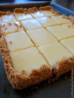 CREAMY LEMON SQUARES: FOR THE CRUST 4 tablespoons butter, melted and cooled, plus more for pan cup graham cracker crumbs ¼ cup sugar FOR THE FILLING 2 large egg yolks 1 can ounces) sweetened condensed milk ½ cup fresh lemon juice lemons) How Yummy Treats, Sweet Treats, Yummy Food, Delicious Recipes, 13 Desserts, Dessert Recipes, Paleo Dessert, Easy Lemon Desserts, Key Lime Desserts