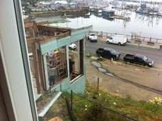Removing large plate glass windows, Quade Construction, Pacific Maritime & Heritage Center, Newport, Oregon  6 September 2012