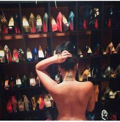 """Urban model"" Stephanie Santiago showing off her tattoo. Someone gotta pay for dem shoes, AMIrITe!?! Eye of Horus inside pyramid with Babylonian sun rays (Baal/Satan worship)"