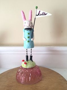 After years spent needle felting, I recently returned to working in clay, and I'm having so much fun! This bunny is handpainted polymer clay, standing on vintage glassware.
