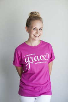 """I will hold myself to a standard of grace not perfection"" extra soft tee in fuchsia, turquoise or pink. $18 at EmilyLey.com. Modeled by Ashlee Proffitt. http://pict.com/p/5d"