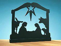 NATIVITY SILHOUETTE    Our wooden hand-cut silhouette of the nativity is intended to decorate a window ledge where light can shine through.