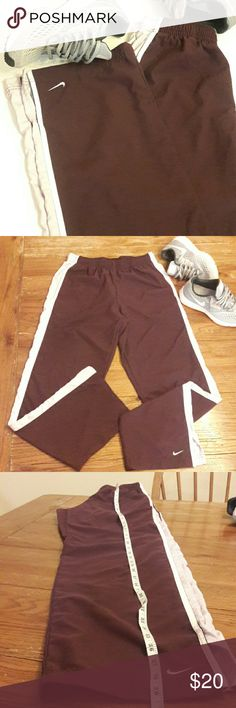 Nike Windbreaker Sweatpants Gently Used Sweatpants-so comfy! Size Small 4-6. These are a plum purple color pics are showing a good color wise! Nike Pants Track Pants & Joggers