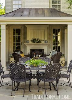 Pretty, Polished Garden in Illinois | Traditional Home. I like the windows on each side of the fireplace.