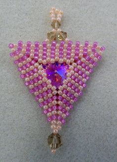 Kelly from Off the Beaded Path, in Forest City, North Carolina shows you how to make a beautiful pendant. We have materials used to make this pendant, along ...