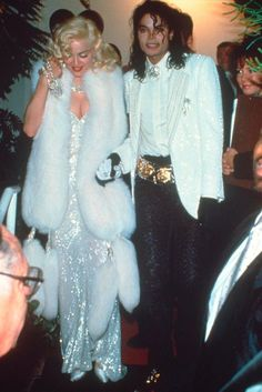 Madonna  Two musical icons – Madonna and Michael Jackson – were pictured together at the 1991 Oscars where the former performed the Dick Tracy track, Sooner or Later, as part of the ceremony. Madonna channelled an old school Hollywood look in a strapless bejwelled gown by Bob Mackie, a white fur stole and bleached blonde curls. (1991)