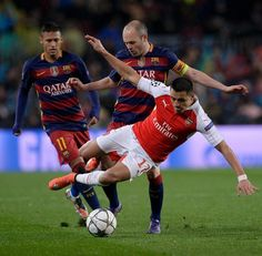 Barcelona's midfielder Andres Iniesta (C) vies with Arsenal's Chilean forward Alexis Sanchez (R) next to Barcelona's Brazilian forward Neymar during the UEFA Champions League Round of 16 second leg football match FC Barcelona vs Arsenal FC at the Camp Nou stadium in Barcelona on March 16, 2016.