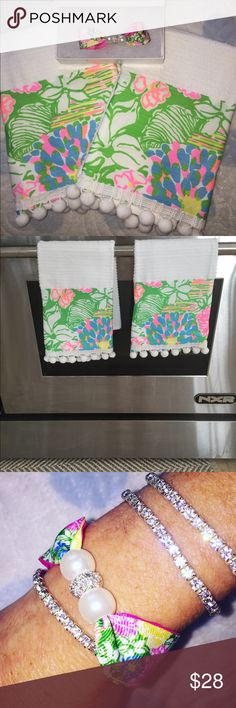 "Lilly Pulitzer Hibiscus Stroll Set Perfect gift! New in box magnetic Pearl rhinestone bracelet and set of two Pompom kitchen hand towels made with Lilly Pulitzer Hibiscus Stroll.  Towels measure 16x19"" and bracelet 7""..not Lilly Pulitzer brand.💕💕 Accessories"