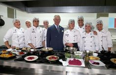 Prince Charles, Prince of Wales meets chefs during a visit to a 'Skill School' on October 29, 2014 in Bogota, Colombia.