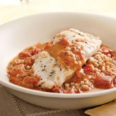 Cod with Tomato Cream Sauce for Two  So yummy! We didn't use white wine and substituted plain yogurt for the cream.