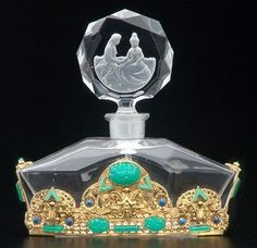 Glass Perfume Bottle w/Ornate Gold filigree Base and shoulder Detail inset w/Turquoise and Blue Stones by 'Lalique' ✿❦✿❦✿ Lalique Perfume Bottle, Antique Perfume Bottles, Vintage Perfume Bottles, Parfum Mademoiselle, Perfumes Vintage, Bottle Art, Clear Crystal, Slab Pottery, Ceramic Pottery