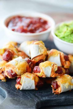 These Mexican Pigs In A Blanket are easy to make, full of flavor, and delicious dipped in salsa and guacamole. One of the MOST POPULAR appetizers just got even better with a MEXICAN TWIST! They are perfect for parties, celebrations, and game day. Easy To Make Appetizers, Popular Appetizers, Appetizers For Party, Bread Appetizers, Appetizer Ideas, Yummy Appetizers, Mexican Fiesta Food, Mexican Appetizers, Mexican Recipes