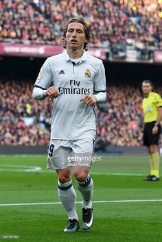 Luka Modric of Real Madrid CF looks on during the La Liga match between FC Barcelona and Real Madrid CF at Camp Nou stadium on December 3, 2016 in Barcelona, Spain.