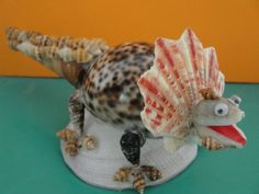 This beautiful figurine was made from natural sea shells various shades, types, textures & sizes and decorated with beautiful details. It would be great gift or a wonderful addition to any collection. Philippines.  Size : 2.6W x 6L x 3H