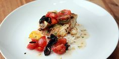 A tasty fish dish paired with rice and a tomato salad. A must-try!