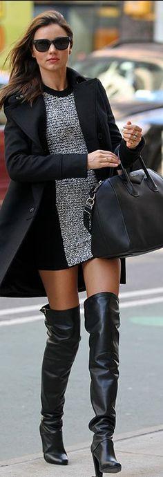 Who made  Miranda Kerr's black sunglasses, gray panel dress, black coat, and black handbag that she wore in New York?