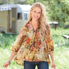 """LAUREN TUNIC-AUTUMN--Pintuck after pintuck, our silk crinkle chiffon blouse paints an alluring picture with feminine details in a distinct print. Self-tie front. Dry clean. Imported. Sizes XS (2), S (4 to 6), M (8 to 10), L (12 to 14), XL (16). Approx. 27-1/2""""L."""