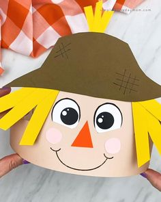 This scarecrow headband is a fun fall or Thanksgiving craft for kids to make! Download the free printable template in the craft version or the black and white version for kids to color in! It's perfect for toddlers, preschoolers, and kindergarten children.