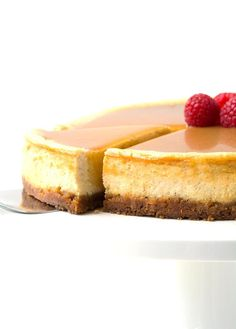 Baked Eggnog Cheesecake with maple caramel and fresh strawberries
