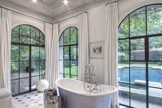Arched steel doors and windowsThis is a Summerour designed house in Atlanta was featured on This Photographer's Life