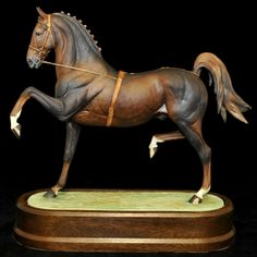 A Royal Worcester model of a Hackney Stallion, modelled by Doris Lindner, limited edition No262/500, model number RW3935, height 25.5cm, with plinth and certificate