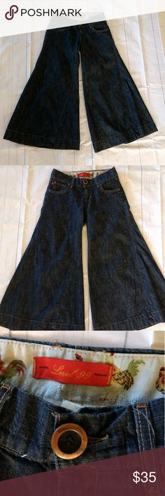 """Anthropologie Level 99 Denim Gaucho Culottes 25 Anthropologie level 99 gaucho culottes size 25 dark wash denim wide leg approx measurements inseam 25"""" rise 7 1/2 waist 28"""" leg opening 19"""" 100% Cotton made in United States in very good pre-owned condition level 99 Pants Wide Leg"""