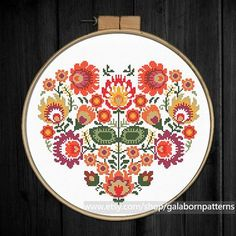 Title: Autumn floral heart ornament Based on traditional Polish embroideries This PDF counted cross stitch pattern available for instant download. Skill level: Beginner+. Pattern size (without white borders around): stitches: 112h x 130w ready design: 8.0h x 9.4w for 14-count fabric. You can frame it in 10 hoop, 10x10 frame (or bigger), or make the pillow cover Floss: 11 DMC colors 14-count Aida fabric Perfect match with: https://www.etsy.com/listing/524669085/fl...