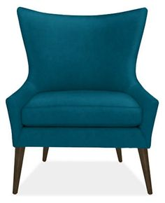 The Lola chair makes a style statement with a low, sculpted back and ultra-thin arms that cradle the seat cushion. Angled, tapered legs complete Lola's petite, yet dramatic shape.
