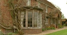"""Remember the ivy-covered country house featured in the Merchant-Ivory movie """"Howards End""""? It's on the market in Oxfordshire, England. Petits Cottages, Howard End, Little Cottages, Tudor House, English House, Filming Locations, Bay Window, Historic Homes, Life Inspiration"""