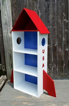 The perfect bookshelf for any little space ranger! #space #rocket #rocketship #spaceship #bookshelf #boysroom #boysdecor #shelving #bookshelf